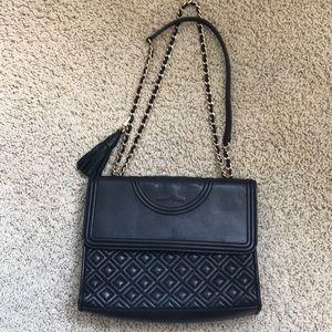 Black Tory Burch shoulder bag with gold hardware